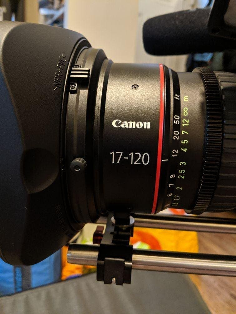 The front element of the CN7 17-120mm lens showing the mandatory lens support