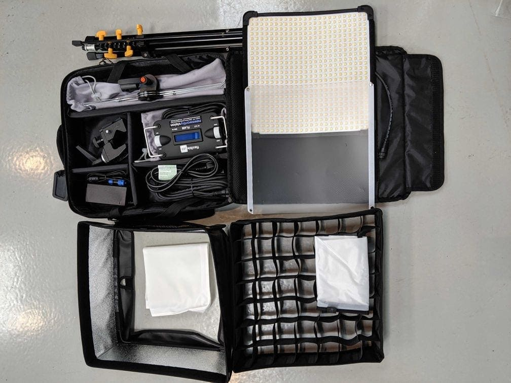 A singular FL-600 kit opened up, showing the mat, diffusers, eggcrate, softbox, controller and cabling